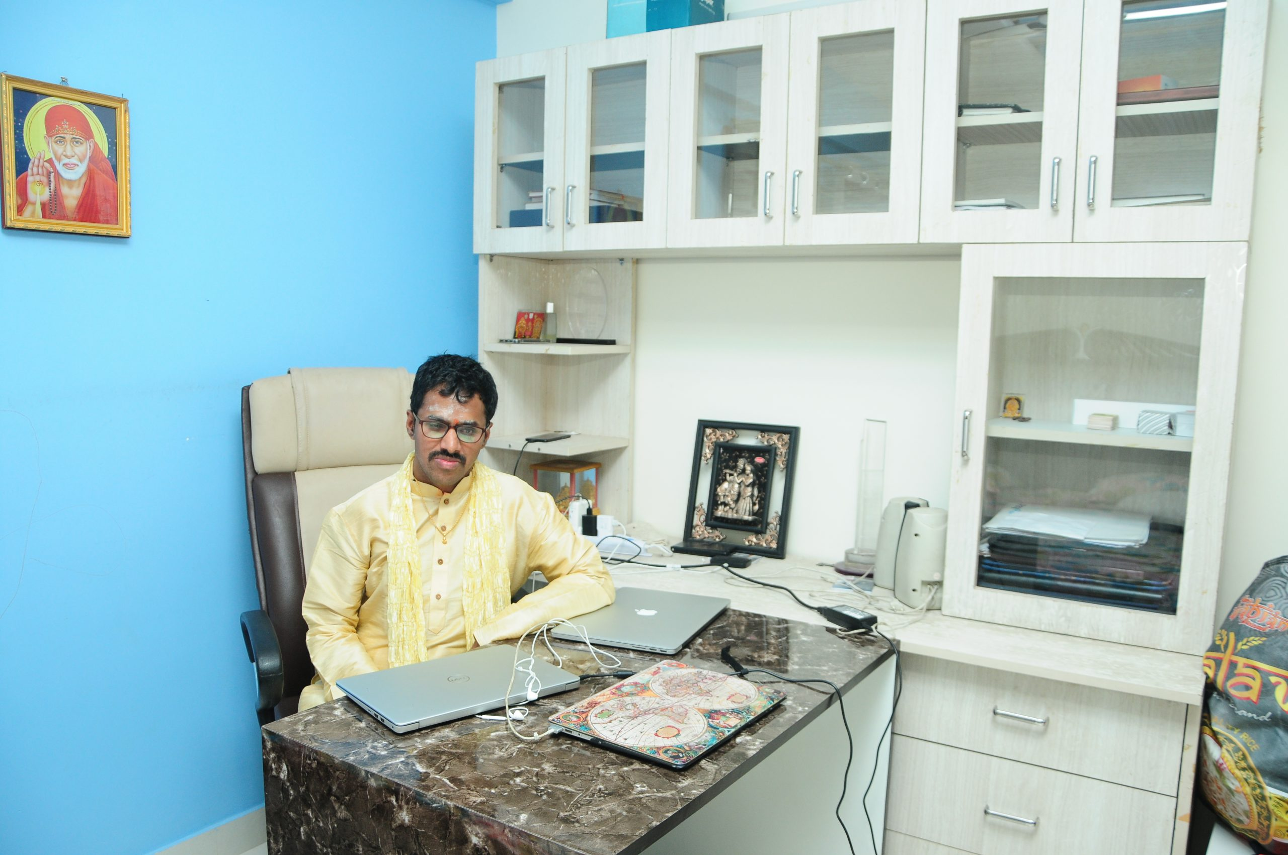 Srinivasu sitting at his home office